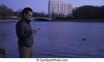 Young man with a smartphone outdoors