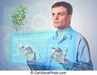 Young man with a virtual keyboard