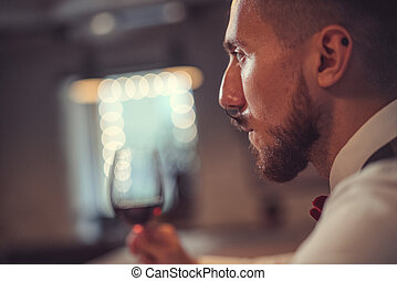 Young man with a wine glass