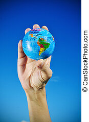 young man with a world globe in his hand, vignetted -...