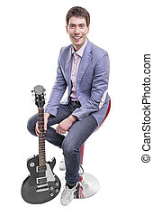 Young man with an electric guitar.