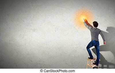 Young man with an electric light bulb
