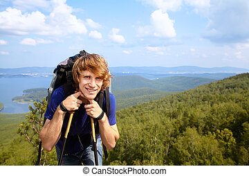 man with backpack hiking in the mountains