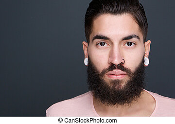 Young man with beard and piercings - Close up portrait of a...