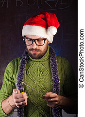 young man with beard in a green knitted sweater