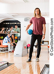 Young Man With Bowling Ball in Club