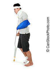 young man with broken leg on crutch