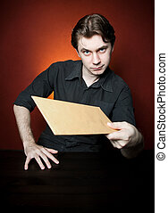 Young man with brown envelope