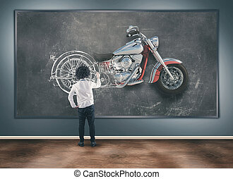 Young man with chalk draw a motorcycle
