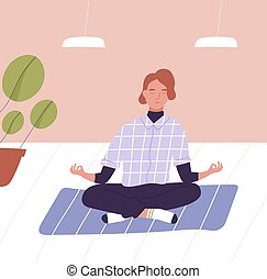 Young man with closed eyes sitting cross legged and ...