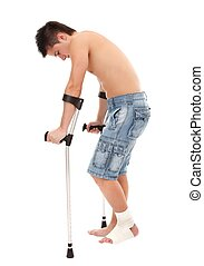 Young man with crutches