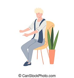young man with cute hair sitting on a chair next to a pot