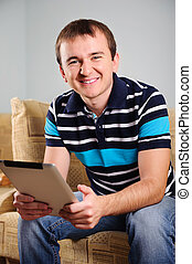 Young man with digital tablet at home