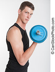 Young man with dumbbell