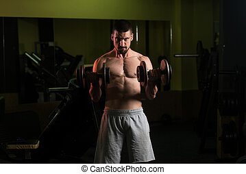 Young Man With Dumbbells Exercising Biceps