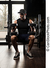 Young Man With Dumbbells Preparing Time