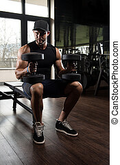 Young Man With Dumbbells Resting Time