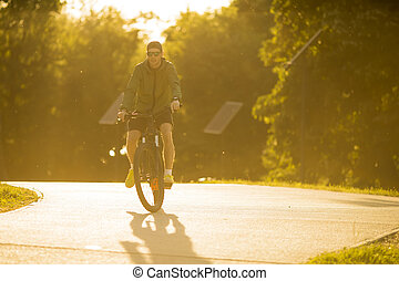 Young man with ebike, mountain bike with electric battery, ...
