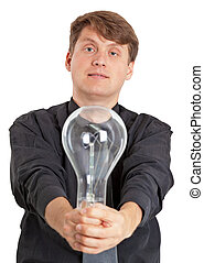 Young man with electric bulb in hands