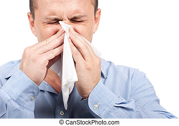 Young man with flu - Young man blowing nose, isolated on...
