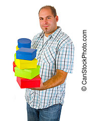 Young man with gift boxes