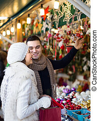 Young man with girlfriend at X-mas market - Smiling handsome...
