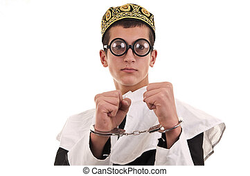 young man with handcuffs costumed in nun for fun, funny religious concept