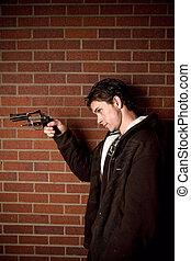 Young man with handgun