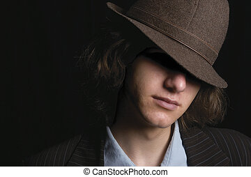 Young man with hat - Young man faces partly hidden by hat