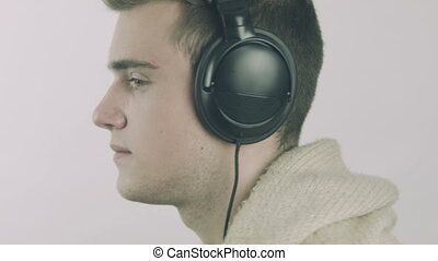 Young man with headphones spinning