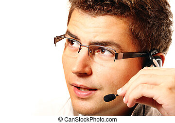 Young man with headset talking - Young handsome worker with...