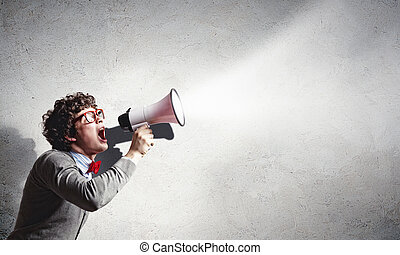 Young man with megaphone - Portrait of young man shouting ...