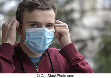 Young man with mouth mask
