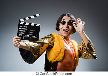 Young man with movie board
