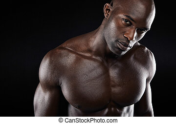 Young man with muscular build - Close-up image of young man...