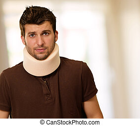 Young Man With Neck Brace, Indoor