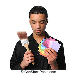 Young Man With Paintbrush and Swatches