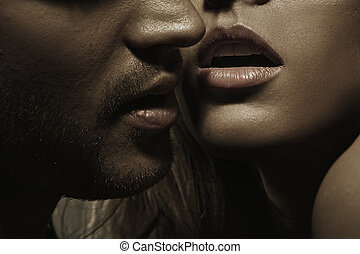 Young man with perfect facial hair and sensual lips of a lady