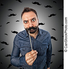 Young man with photo booth shaped mustache and background...