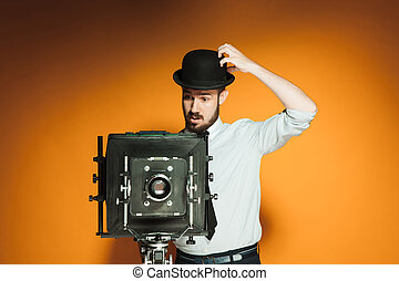 young man with retro camera