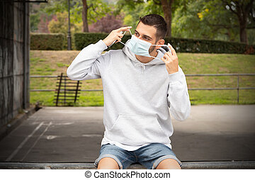 young man with sanitary mask outdoors
