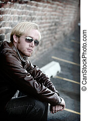 Young man with sunglasses - Young man with blonde hair and...