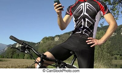 Young man with telephone on bicycle