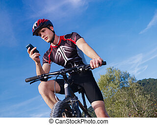 young man with telephone riding mountain bike - sports ...