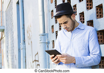 young man with the phone on the street