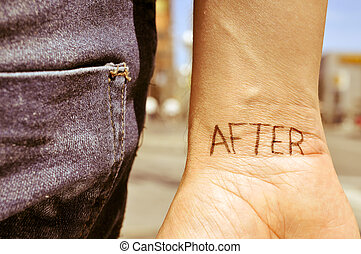 young man with the word after tattooed in his wrist