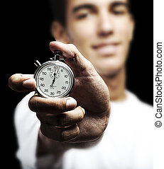 young man with timer - portrait of young man holding a...