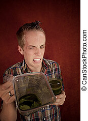 Young man with unappetizing health shake - Young man...