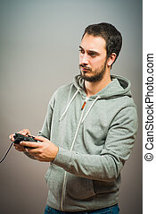 Young man with video game controllers