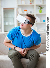 Young man with virtual reality goggles